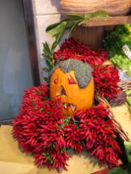 jack-o-lantern in shop window with peppers
